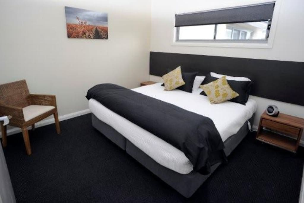 Executive bedroom - available with King or 2 King Singles. Quality linen provided.