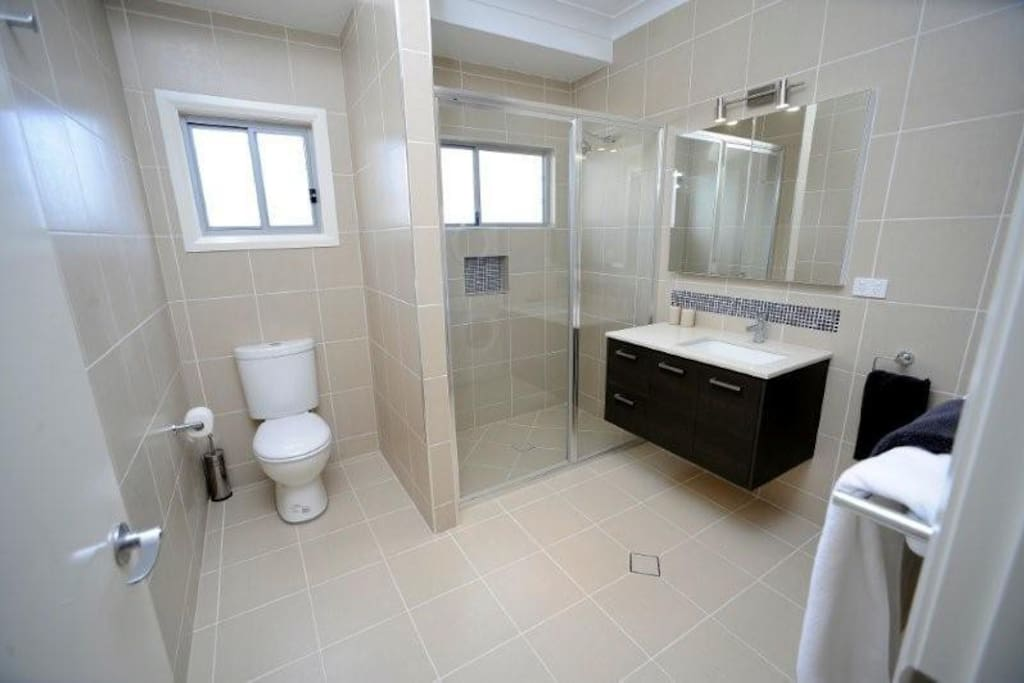 Executive apartment bathroom - Plenty of room to move. Also has a washing machine and dryer.