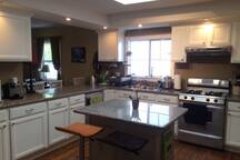 Large kitchen w/skylight, island, lots of counter space.