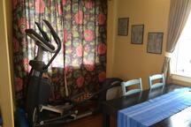 Bonus room with elliptical exercise machine.