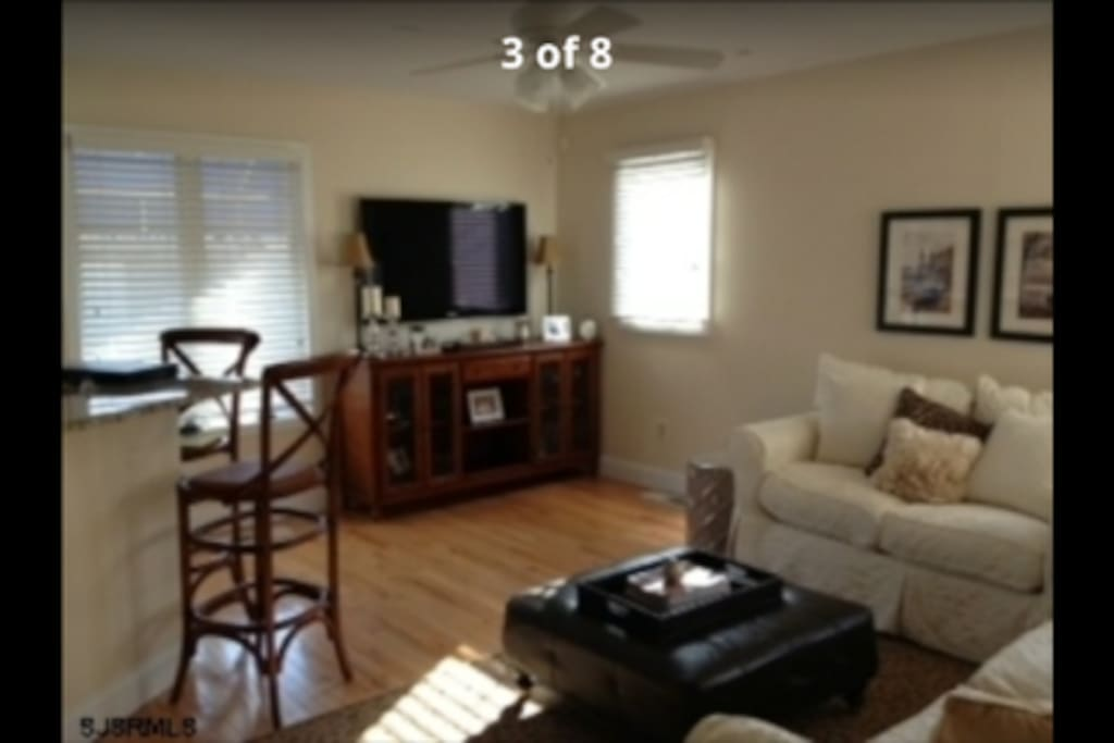 Nice size tv, open space, comfortable couches.