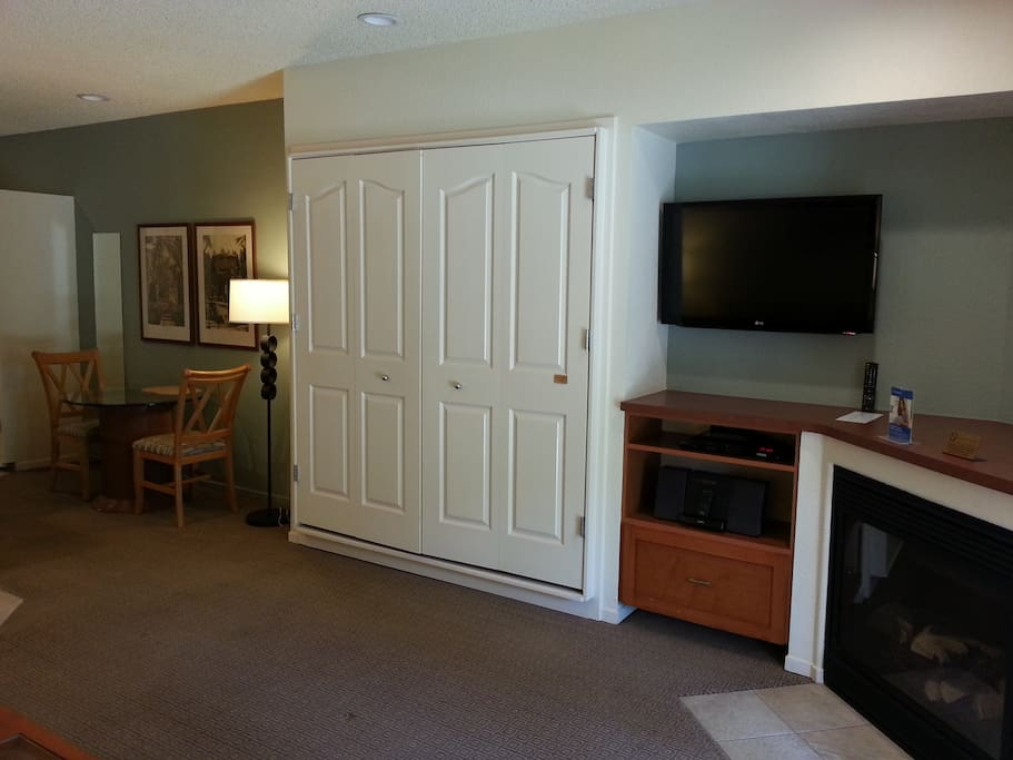 Queen murphy bed on the wall.