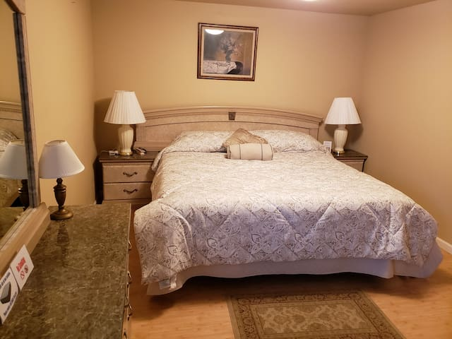 King size bed with heated mattress in second bedroom.