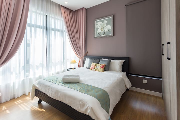 2nd Floor Bedroom 2 with 1 Queen Bed, table lamp and air-conditioner