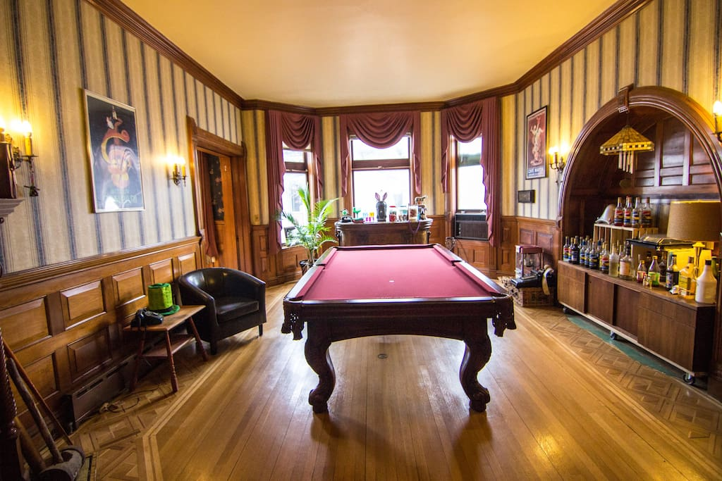 Listen to some music or put a game on the television while you enjoy a game of pool.