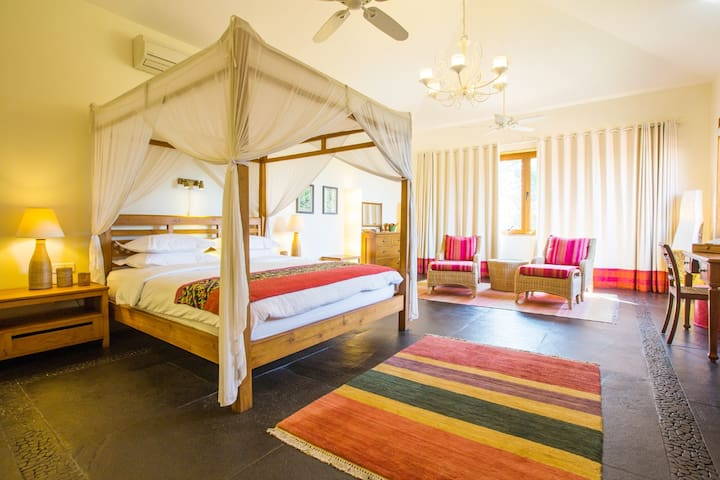 The spacious Coral Suites - shades of reds and pink