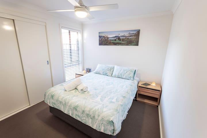 Queen Bed in Main Bedroom dressed in Premium linen
