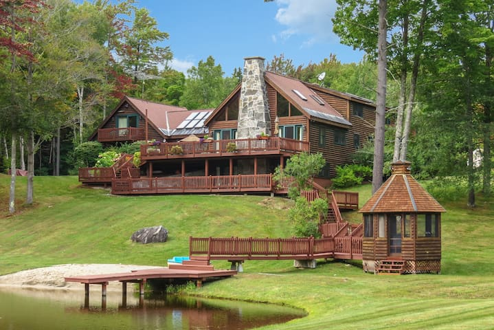 Perfect 7BR Log Estate on 60 Acres with a Pond.