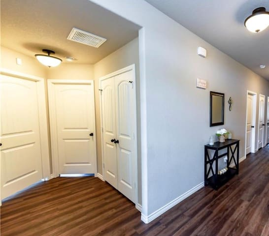 Upon entry of the house, two guest bedrooms will be located to the left.   Both rooms have Roku tv for watching  Netflix  Both rooms have additional air mattresses and closet space.  Note: The house shares the washer and dryer room.