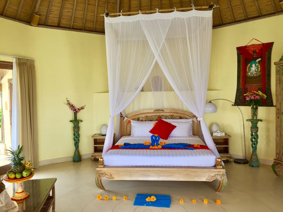 36 sq meters round charming bedroom in separate guest house . Attached bathroom and kitchen. Exquisite Balinese furniture. Brand new natural latex matrass for maximum relaxation. All around terrace with sofa and dining table.