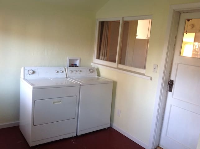 Entry with washer and dryer.