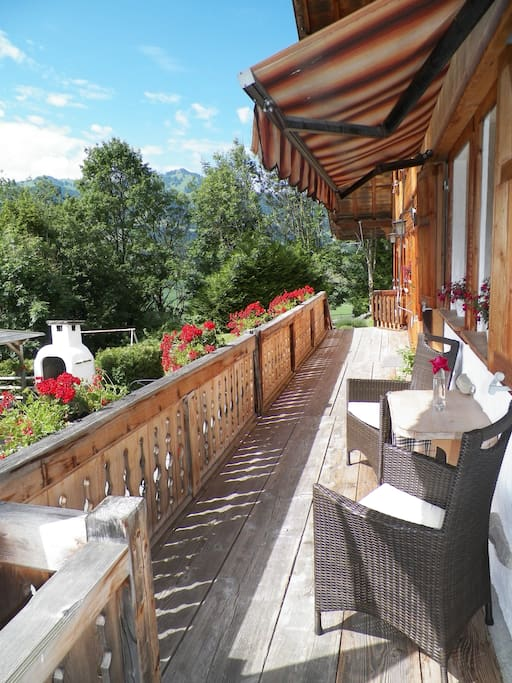 South facing sun terrace with seating area overlooking the Alps.