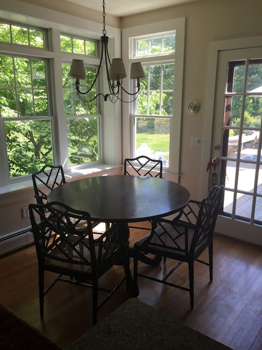 Dining area overlooking deck and backyard.