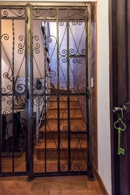 The forged iron gate entrance to the duplex, brown door is another housing