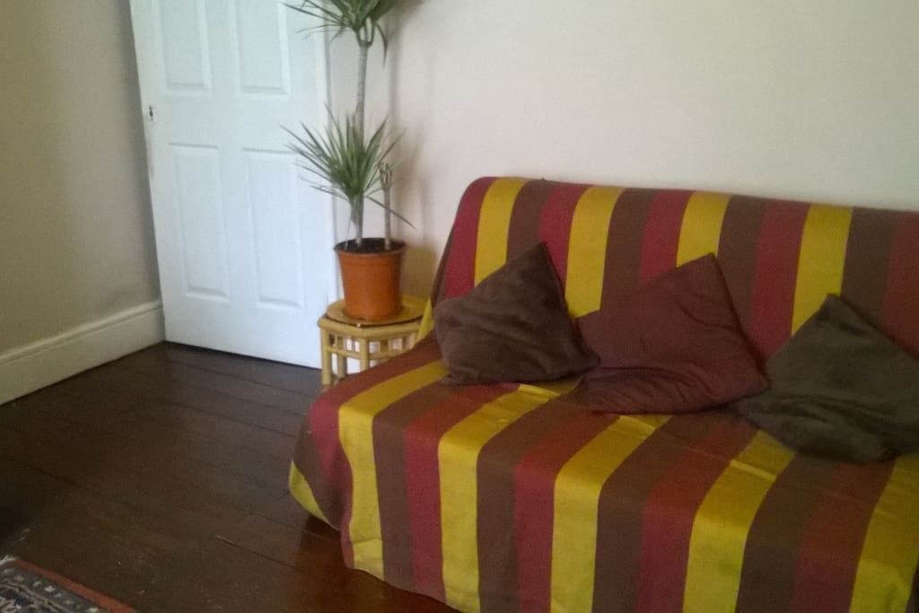 Light and airy spacious living room has a sofa bed ideal for an extra guest or 2 at a set fee.
