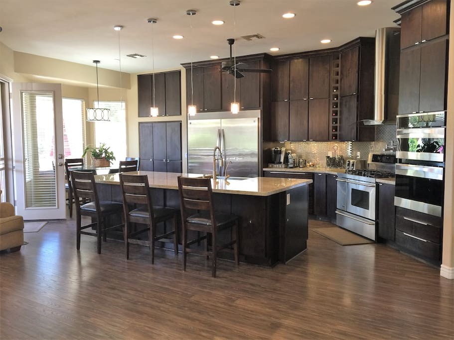 Gourmet kitchen with professional appliances, 3 ovens, huge granite island with seating for 3