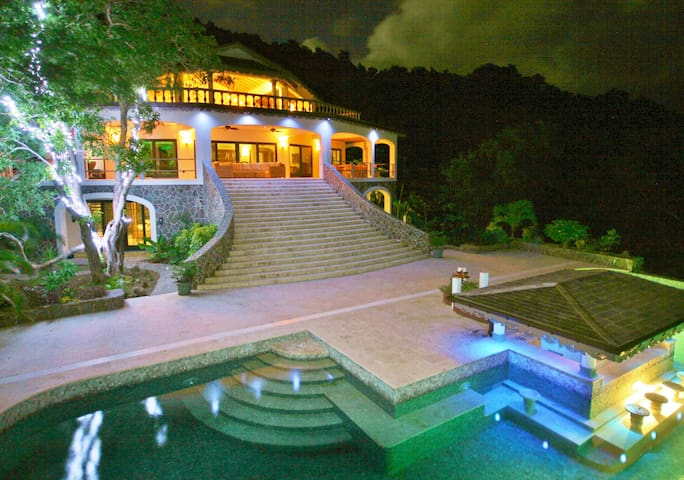A stunning evening photo of Tropical Hideaway Villa and the Infinity Pool