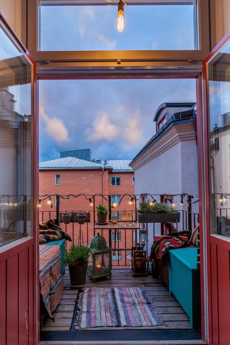 Open up the doors to the balcony for some fresh air.