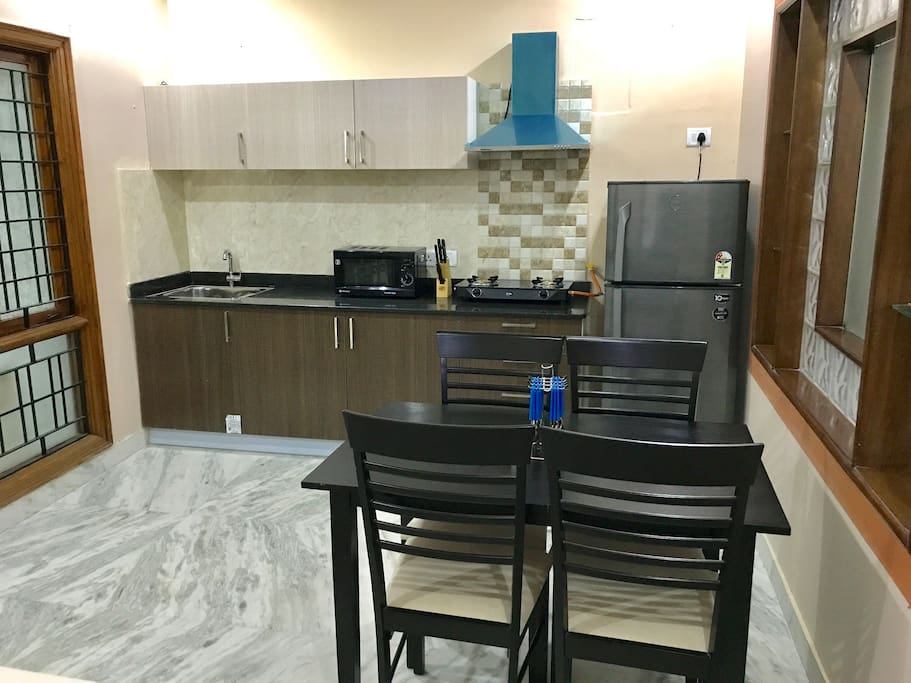 Fully Equipped Kitchen with Stovetop Gas, Refrigerator, Microwave & all cookware plus Dining Table