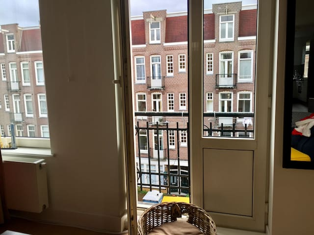 Room in a cozy apartment with a terrace and a cat