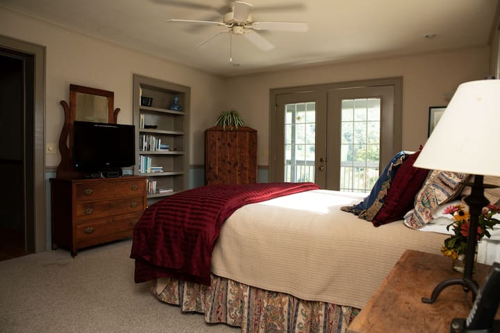 The master bedroom has a queen-size bed and French doors that open onto the porch -- a perfect spot for that first morning cup of coffee or watching the moon climb over the mountains.