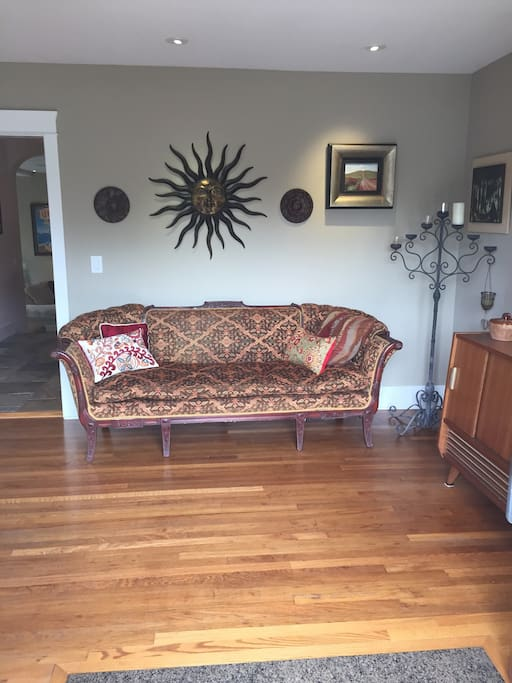 Entry to home, antique and vintage furniture, 78 year original floor to the house