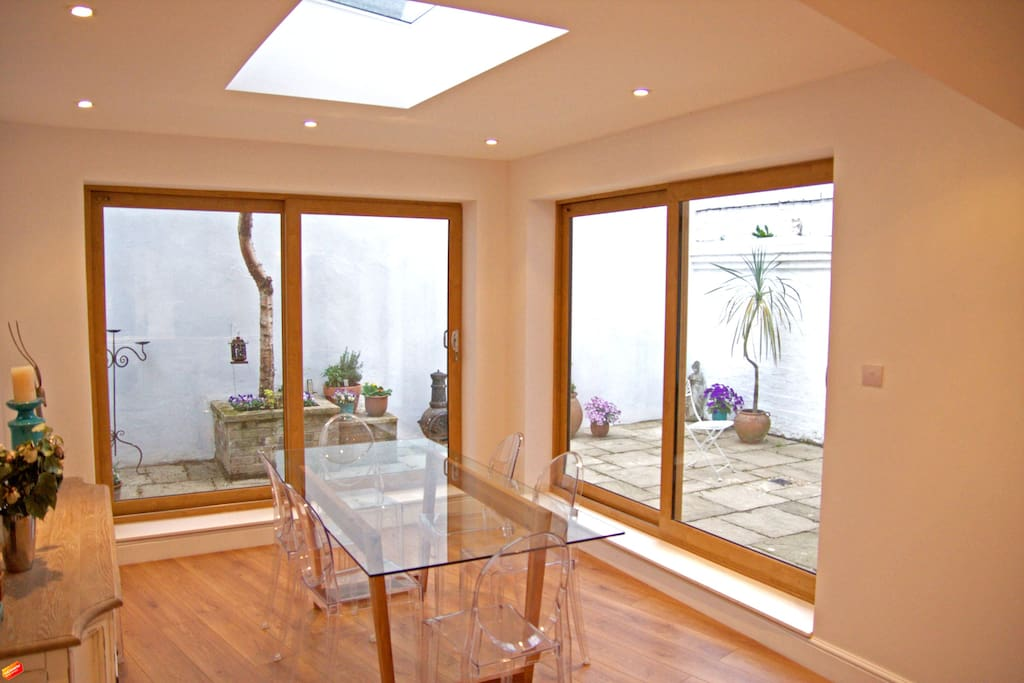 Bright dining room opening into the garden