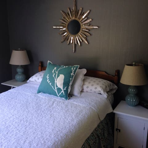 This is a full sized bed with quality bedding. It has a beautiful view of the back yard.