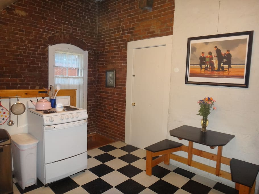 Your kitchen is fully-stocked, and features the charm of exposed-brick walls.