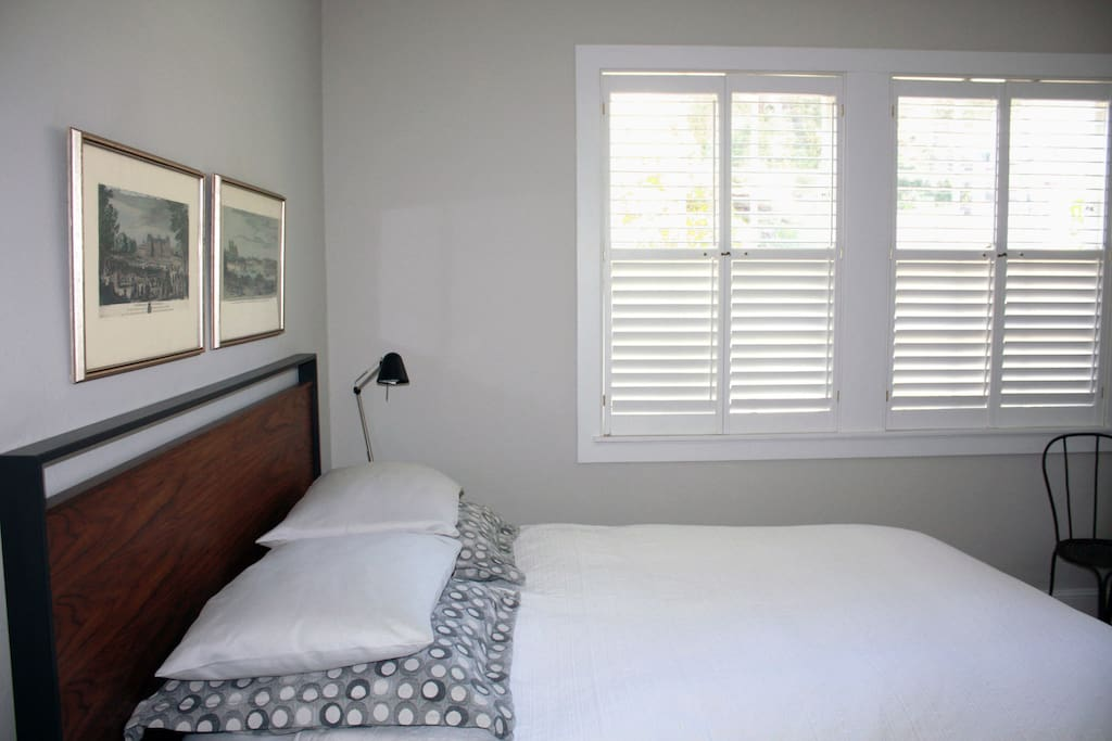 Wood shutters mean you can adjust the light as you choose.