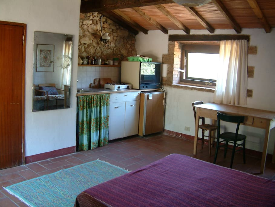 cooking corner, bathroom door left