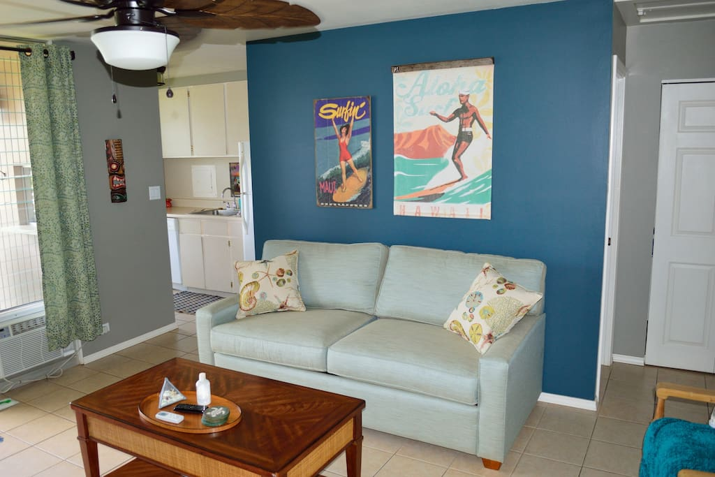 Comfortable couch and seating areas in this Hawaiian themed condo. Queen sofa sleeper with extra deep mattress.