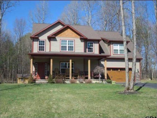 3 Bedroom Adirondack Home fully furnished a very rustic modern feel with hot tub and private deck in back and front. Perfect for a track season rental weekend or more. 5 min from Saratoga Springs!