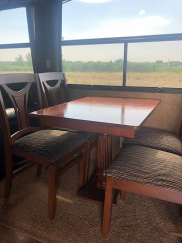 Dining area with view of the orchards and pea field.