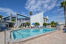 "The Madeira Beach Yacht Club property boasts TWO beautiful and heated pools for your enjoyment.  Tables & chairs as well as umbrellas are available for your use. If you're bringing ""refreshments"" please use plastic cups."