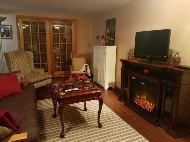Two warm lit rooms in a relaxing country setting