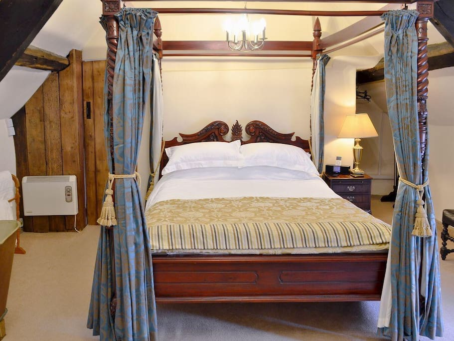 The king size four poster bed is a wonderful addition to the medieval cottage