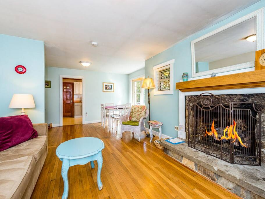 Head to the open living area to warm up by the cozy gas fireplace with stone surround.