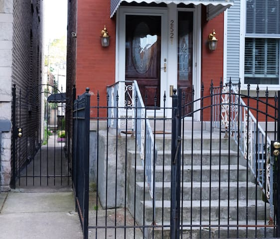 Use gate to left of front door to enter the garden apartment under the awning.