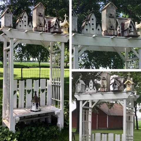 Our yard furniture  features a Vintage Arbor Seat with an Antique Collection of Distressed Birdhouses on top. This is a quiet and secluded place to watch the fireflies during the long summer evenings.