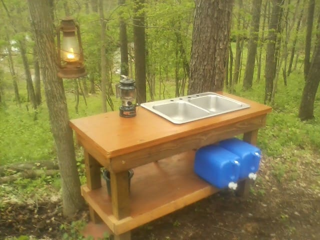 outdoor sink and food prep area
