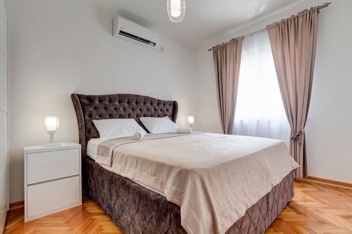 Bedrooms do not have much unnecessary details - plain king-size bed, night stands, lamps and air-conditioning device are just what it takes to guarantee good nights' sleep.