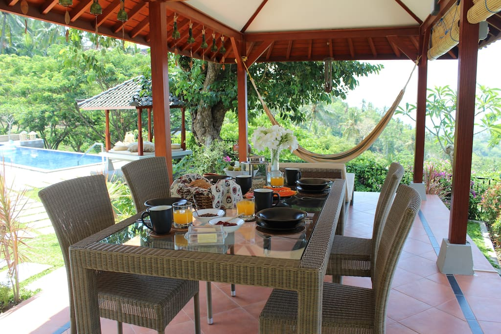 Enjoy breakfast on the gazebo outside your room!