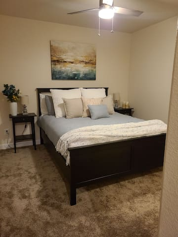 Comfortable, and elegantly decorated queen bed.