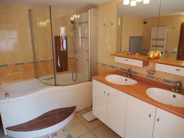 The Bathroom including a large Bathtub