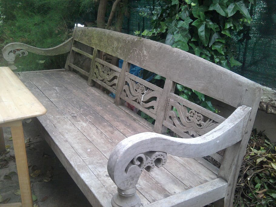 Relax under the umbrella on the antique teak bench from Bali while you enjoy the fragrance of the jasmine