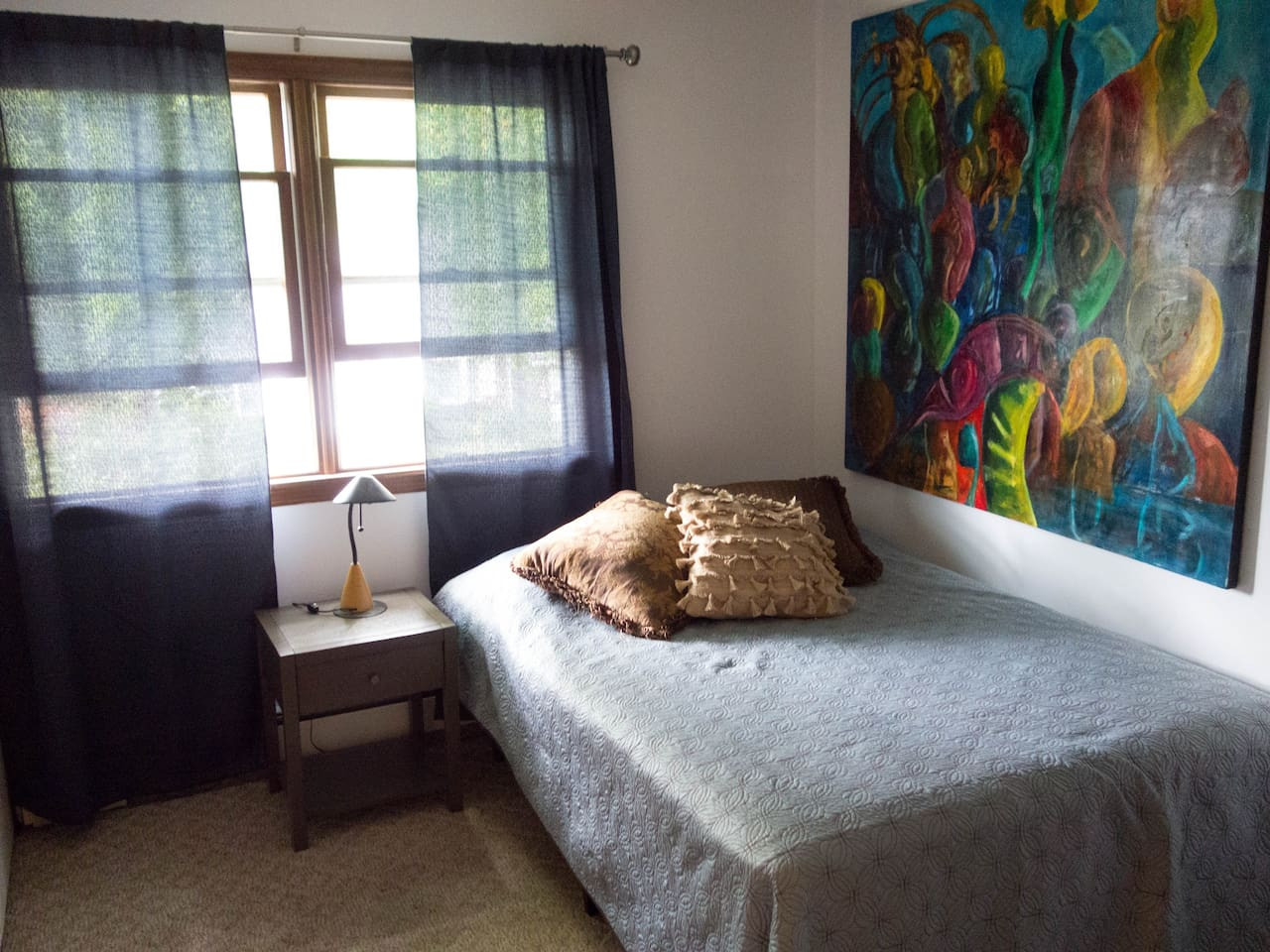 Guest room with wifi, air conditioner and fan available...full size bed and fresh linens.