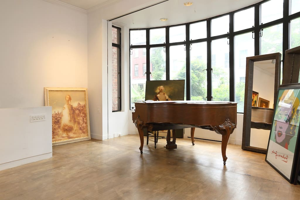 Beautiful grand piano for use overlooking the courtyard!