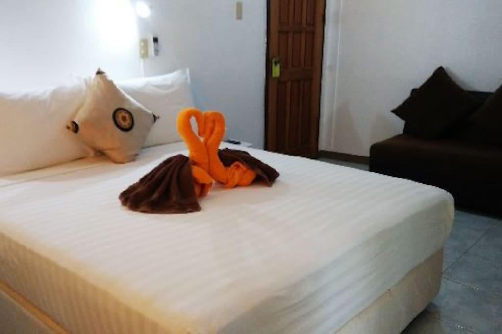 Fully air-conditioned room with basic kitchenette and small balcony. With convenient access to rooftop terrace overlooking the beachfront, fully equipped with sunloungers tables, chairs and waitress call button.