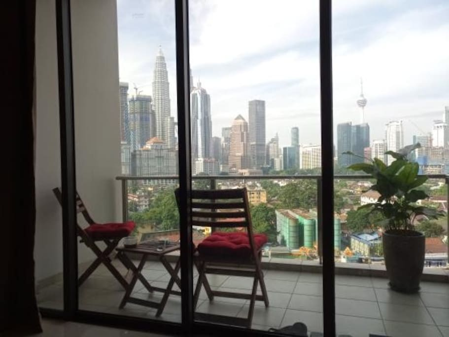 Balcony chairs and stool to enjoy the view while sipping your favourite coffee/wine